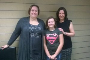 Delighted client Sarah Whittle and her daughter Amy met with solicitor Sue Robinson at our offices.